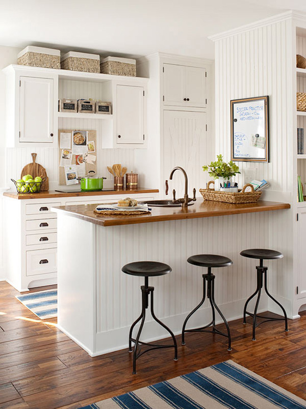 10 Ideas for Decorating Above Kitchen Cabinets | Not sure what to do with that awkward space above your kitchen cabinets? Check out these 10 stylish solutions for decorating above kitchen cabinets. | TheCasaCollective.com | #interiordesign #decoratingabovecabinets #kitchens